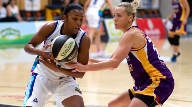 Capitals guard Renee Montgomery looks for a way past the Melbourne Boomers' defence.