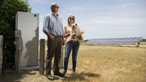Dominic and Jane Osborne with solar array and battery storage pack.