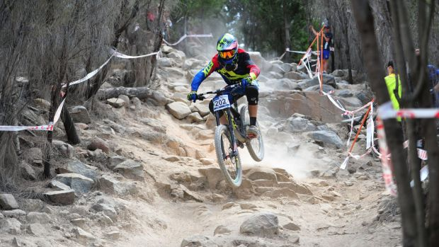 Dream job: Canberra's Jackson Frew on his way to winning the junior men's downhill at Stromlo on Sunday.