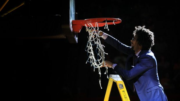 End of an era: Josh Childress cuts down the nets at the Kingdome.