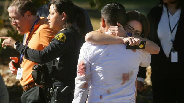 A couple embrace following the San Bernardino shooting in early December.