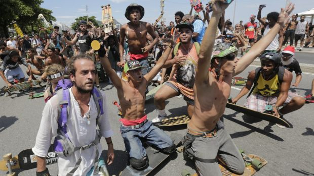 Skateboarders argue with demonstrators during a march calling for the impeachment of Brazilian President Dilma Rousseff  ...