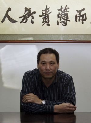 Chinese lawyer Pu Zhiqiang, whose trial is throwing harsh light on the government's attitude to dissent. Above his head ...