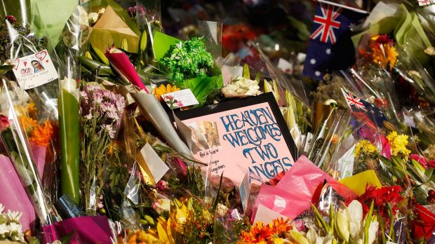 Messages and flowers placed in respect of the victims of the Lindt Cafe siege in Martin Place, Sydney, in December 2014. ...