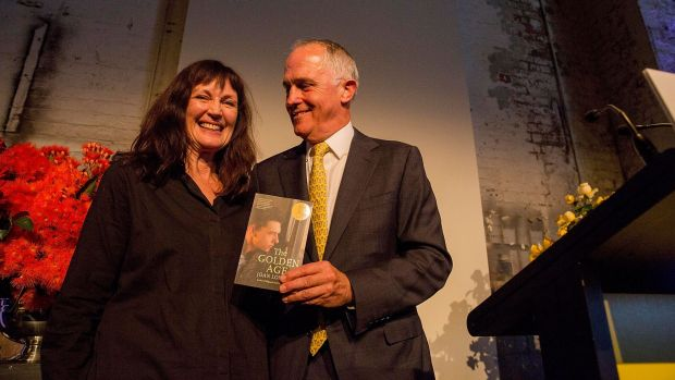 Joan London receives the Prime Minister's Literary Award for Fiction from Malcolm Turnbull.