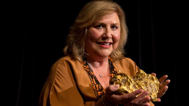 Australian Museum director Kim McKay with a 10-kilogram gold nugget that was in a box used as a cricket stump by ...