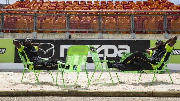 Andre Russell and Stefanie Taylor take five on the beachside chairs at Spotless Stadium.
