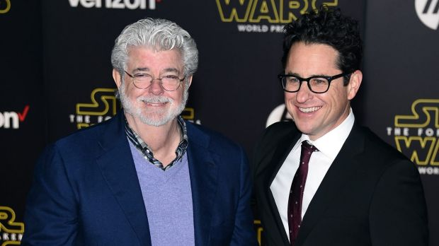 George Lucas (left) and writer/director J.J. Abrams attend the premiere of Walt Disney Pictures and Lucasfilm's <i>Star ...