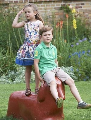 Prince Christian sitting alongside his younger sister, Princess Isabella.