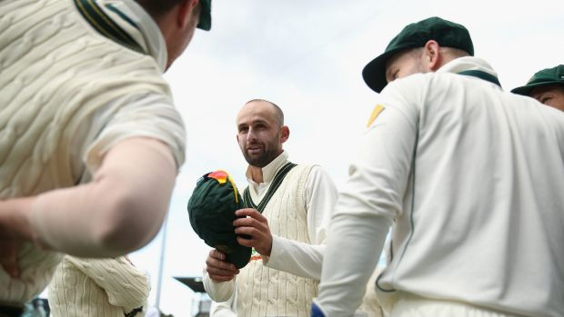 In the money: Nathan Lyon talks to teammates during the first Test match against the West Indies.