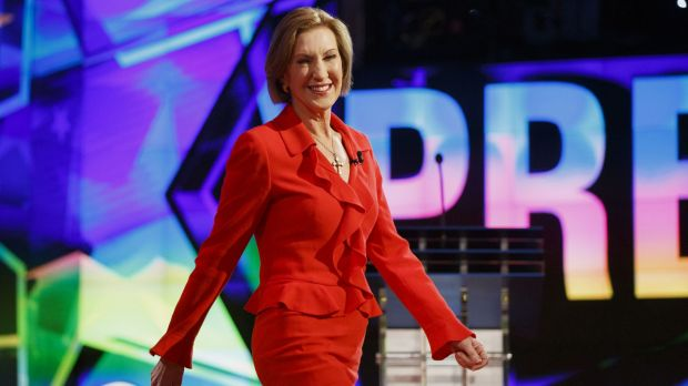 Carly Fiorina walks on stage at the start of the first Republican debate.