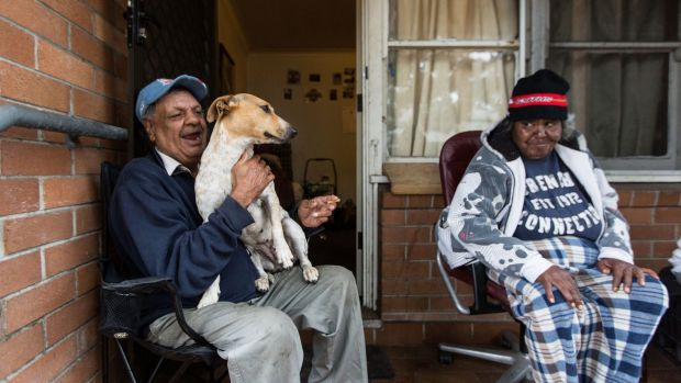 Waterloo public housing resident Walter Murray with Rose Dodson and Mr Murray's dog Scrappydoo. Mr Murray has greeted ...