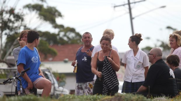 Residents gather outside after the severe storm had passed over Kurnell