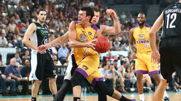 Here he comes: Jason Cadee of the Sydney Kings drives to the basket as Igor Hadziomerovic of Melbourne United defends.