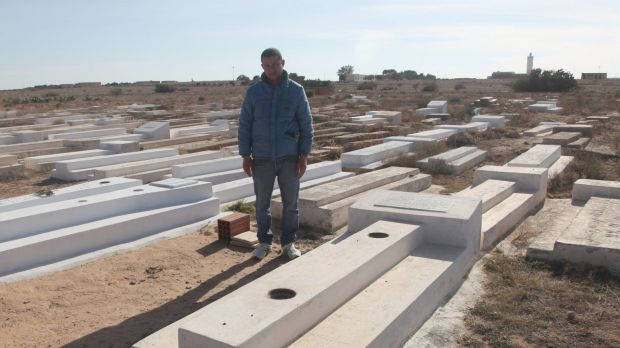 Lotfi Bouazizi, 35, at his famous cousin Mohamed's grave in Sidi Bouzid. Lotfi was in Italy searching for work when his ...