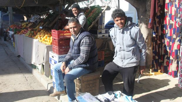 Hmaidia Mohjoub, 34, centre, lost his job because of the revolution and was also unable to find work in Tunis.