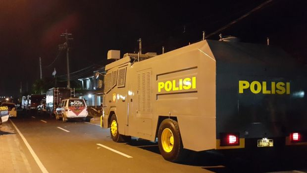Indonesian police vehicles stand outside Bali's Kerobokan jail after the gang battle.