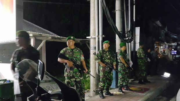 Indonesian soldiers stand guard outside Bali's Kerobokan jail after the deadly gang fight.
