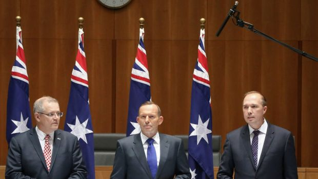 A boom microphone picks up the private conversation of Scott Morrison, Tony Abbott and Peter Dutton  in September last ...