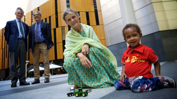 Australian nurse Valerie Browning in Sydney this week with her two-year-old adopted son Nabil. Looking on are her ...