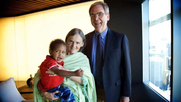 Valerie Browning with her adopted son Nabil, two, and her brother, retired Anglican Bishop of Canberra and Goulburn ...