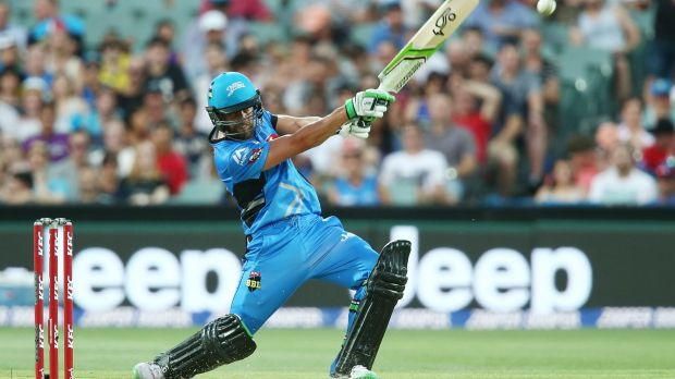 Alex Ross of the Adelaide Strikers slogs a delivery to the boundary during his innings of 65 against the Melbourne Stars.