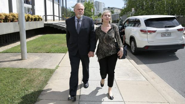 Vytas Kapociunas leaves the ACT Supreme Court on Saturday afternoon with his wife Jane Hardy, a former Australian ...