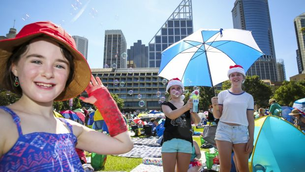 Clare Barber, 8, Isabel Martin, 10, and Juliette Martin, 14, at Carols in the Domain.