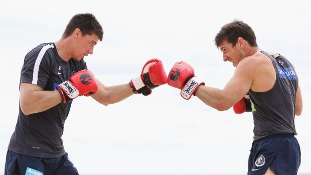 Kid gloves: Matthew Kreuzer (left) and Michael Jamison spar in training.