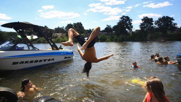 The coolest place in Penrith on Sunday was in the Nepean River.