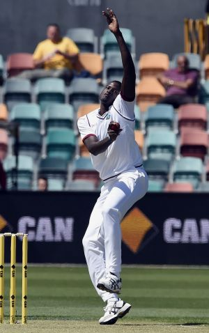 Jason Holder sends down a delivery in the first Test.