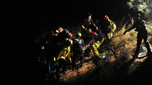 ACT Fire and Rescue crews work to rescue a 17-year-old boy at Ginninderra Falls.