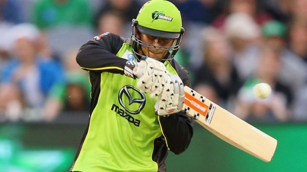 Green with envy: Usman Khawaja cuts for the Sydney Thunder.