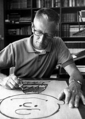 Cartoonist Charles Schulz draws a picture of his cartoon character Charlie Brown in his Sebastopol, Californian home in 1966.