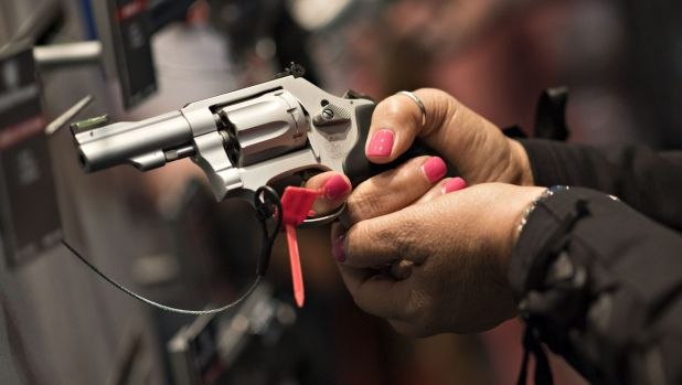 Handgun maker Smith & Wesson says revenue could be 16 per cent  higher than forecast this quarter.