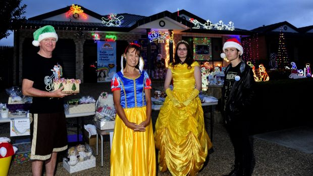 The Anthoney family of Gungahlin. From left, Stephen, Yvonne, Nalani, 21, and Jarrett, 20, with their Christmas lights ...
