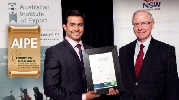AIPE chief executive Amjad Khanche accepting an award from the NSW government.