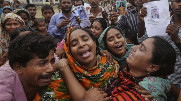 Relatives of Mohammed Abdullah, garment worker in Rana Plaza, cry as they as they arrive to collect his body near Dhaka, ...