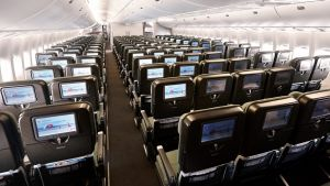 The seats at the rear of the economy section on Qantas 747-400 drop from three to two, creating extra space between the ...