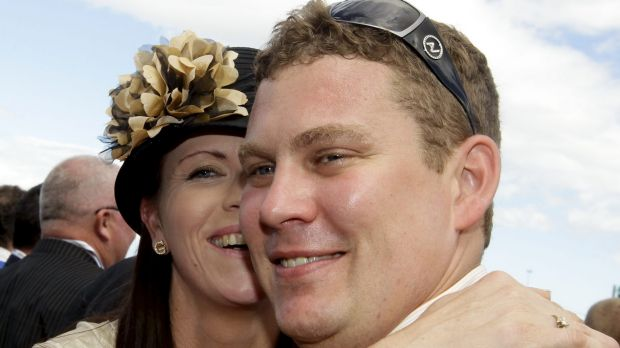 Trainer Trent Busuttin is congratulated by his wife Natalie after jockey Hugh Bowman rode Sangster to victory in the ...