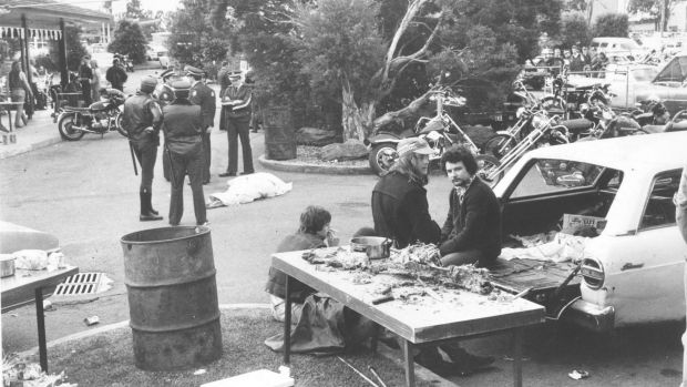 Police guard bodies at the site of the Milperra Massacre where six people died on September 2, 1984.