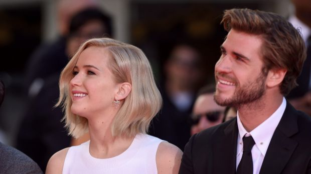 Jennifer Lawrence and Liam Hemsworth pose at <i>The Hunger Games: Mockingjay - Part 2</i> Hand And Footprint Ceremony at ...