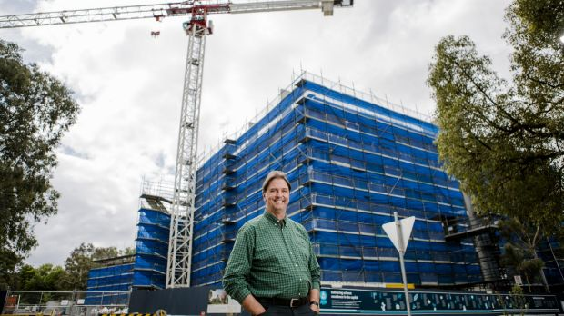Dr John Manners, director of CSIRO Agriculture, in front of a new development site at the CSIRO Canberra.
