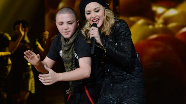 Rocco Ritchie and Madonna perform during the MDNA North America tour opener in 2012.