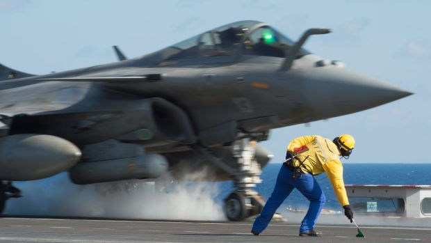 A French fighter jet taking off from the deck of France's aircraft carrier Charles de Gaulle, at the start of France's ...