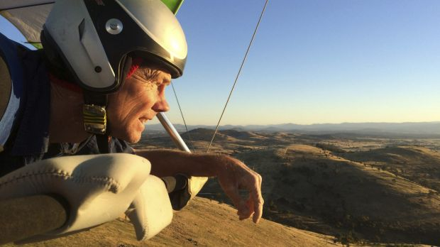 Paraglider Phil Robinson in the sky above Spring Hill near Hall.