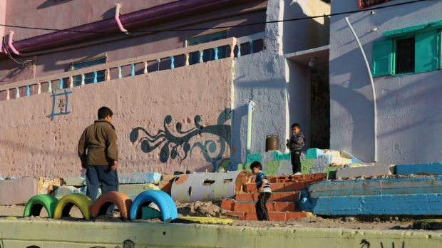 Young boys play outside the brighly-coloured buildings in Gaza's al-Shati (Beach) Camp.