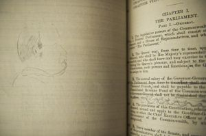 A physical copy of Edmund Barton's 1891 draft Australian constitution with his own scribblings and hand-drawn pictures ...