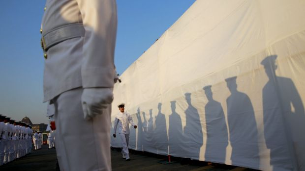 Indian Navy personnel attend a ceremony for the warship Godavari at the dockyard in Mumbai.