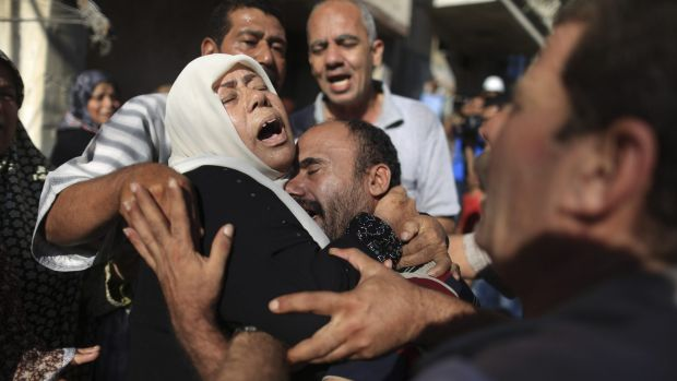 July 2014: Members of the Bakr family mourn during the funeral in Gaza City for four of their children killed on the ...